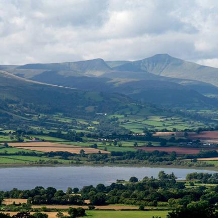 View of Llangorse Lake and the Brecon Beacons. Photo taken on this tour
